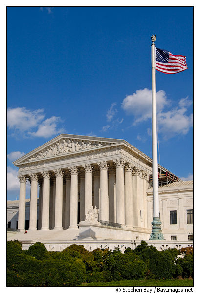 The U.S. Supreme Court and American flag. Washington, D.C., USA.